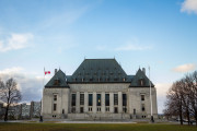 Main Building and headquarters of the Supreme Court of Canada, in Ottawa, Ontario. Also known as SCOC, it is the highest justice body of Canada  picture of the  the entrance of the Supreme Court of Canada, or Cour Supreme du Canada, in Ottawa. The Supreme Court of Canada is the highest court of Canada, the final court of appeals in the Canadian justice system. Its decisions are the ultimate expression and application of Canadian law and binding upon all lower courts of Canada